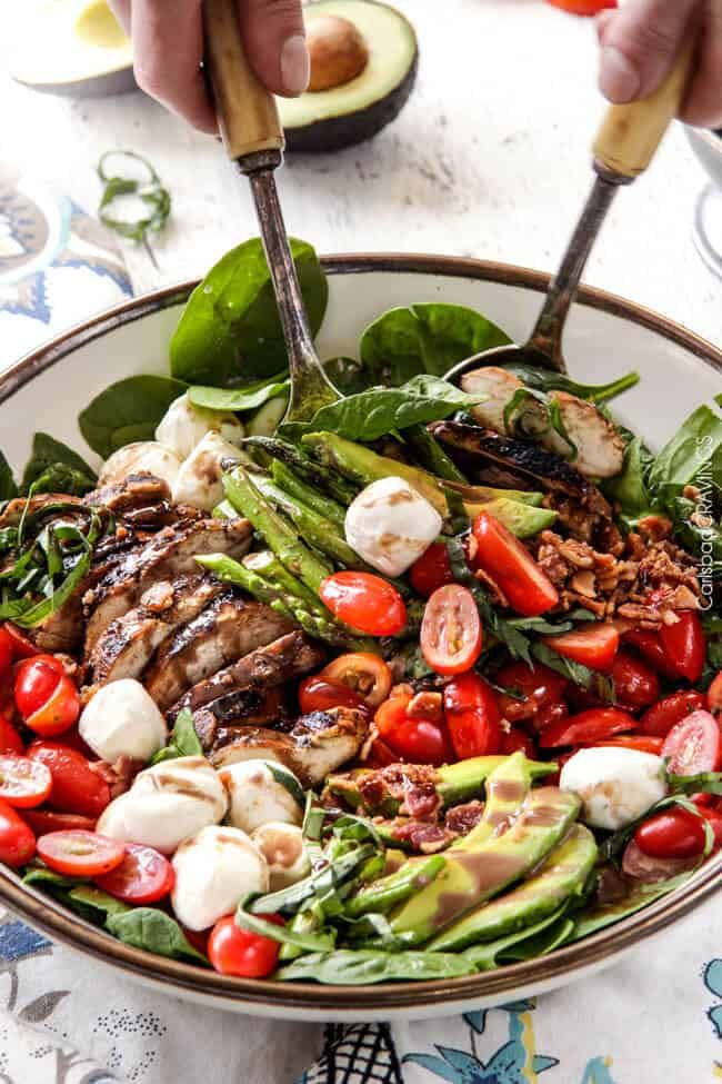Grilled Caprese Chicken Salad with the most incredible balsamic marinated chicken, fresh tomatoes, creamy mozzarella, grilled asparagus, creamy avocado and crispy bacon all drizzled with Creamy Balsamic Reduction Dressing. Out of this world! #summersalad #springsalad