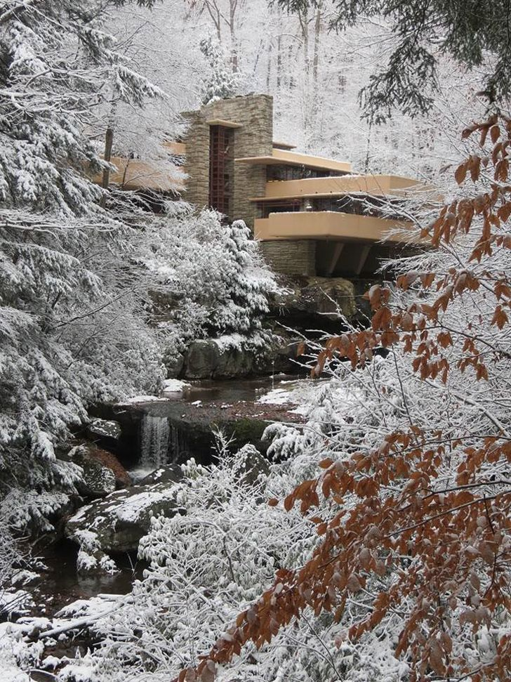 The iconic falling water by frank Lloyd wright during a winter wonderland, beautiful