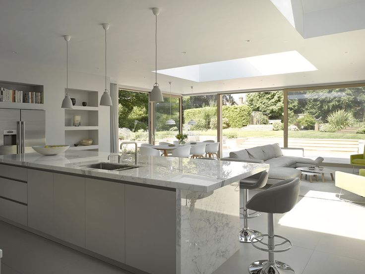 our crook kitchen is a sleek minimal white marble kitchen living and dining space - Marble Kitchen Design