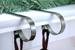 Sterling Pear: Mantle Clip Stocking Holders (set of 4) -- much safer for kids than the heavy ones that just sit on top of your mantle. #sterlingpear #stockinghanger