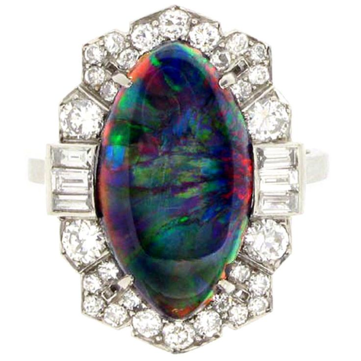 Superb Art Deco Black Opal Diamond Ring Circa 1935. Again, not my style, really, but I like the interplay of colors in the center stone.