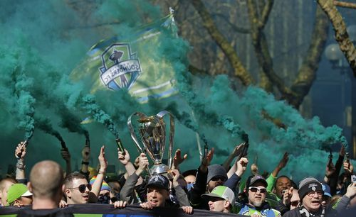 AP                  Published 9:18 p.m. ET March 19, 2017   Updated 4 hours ago        Members of the Emerald City Supporters hold up smoke effects as they take part in the traditional March to the Match with the 2016 MLS Cup trophy before an MLS soccer match between the Seattle...  http://usa.swengen.com/seattle-celebrates-mls-cup-title-with-3-1-win-over-red-bulls/