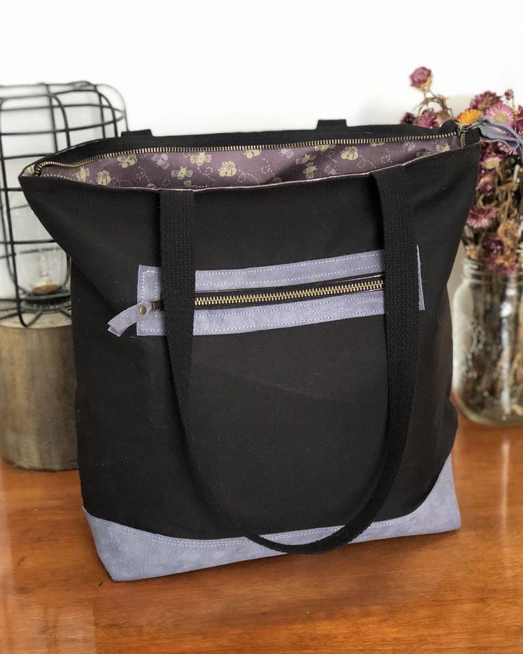 The Wanderer Tote is perfect for wherever your travels may take you – to school, to work, to the market, around the world! This bag has been constructed with medium weight black canvas on the…