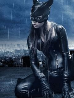 CAT WOMAN IN A DOWNPOUR