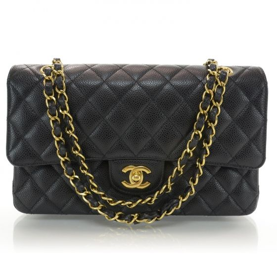 This is an authentic CHANEL Caviar Medium  Large Double Flap Black.   This is a stylish and popular classic from Chanel with all of the hallmarks and quality of a great Chanel handbag.