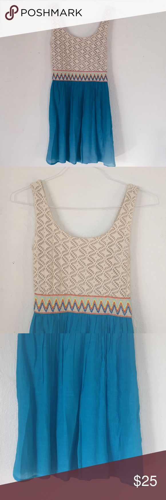 Charlotte Russe Beachy Summer Dress Charlotte Russe dress with coral blue skirt with attached slip so not see through. Top part with sandy tan colored knit fabric. Waist band with fun zig zag striped design of blue orange and yellow. Very comfortable and great for warm weather. No flaws. Offers welcome. Charlotte Russe Dresses Mini