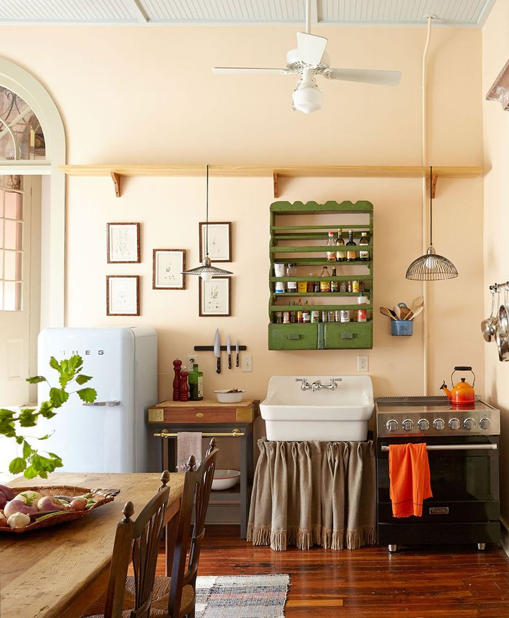 A spirited mix of vintage fittings outfit the kitchen of  New York–based TV producer-director Chris Fisher| via Lonny.com