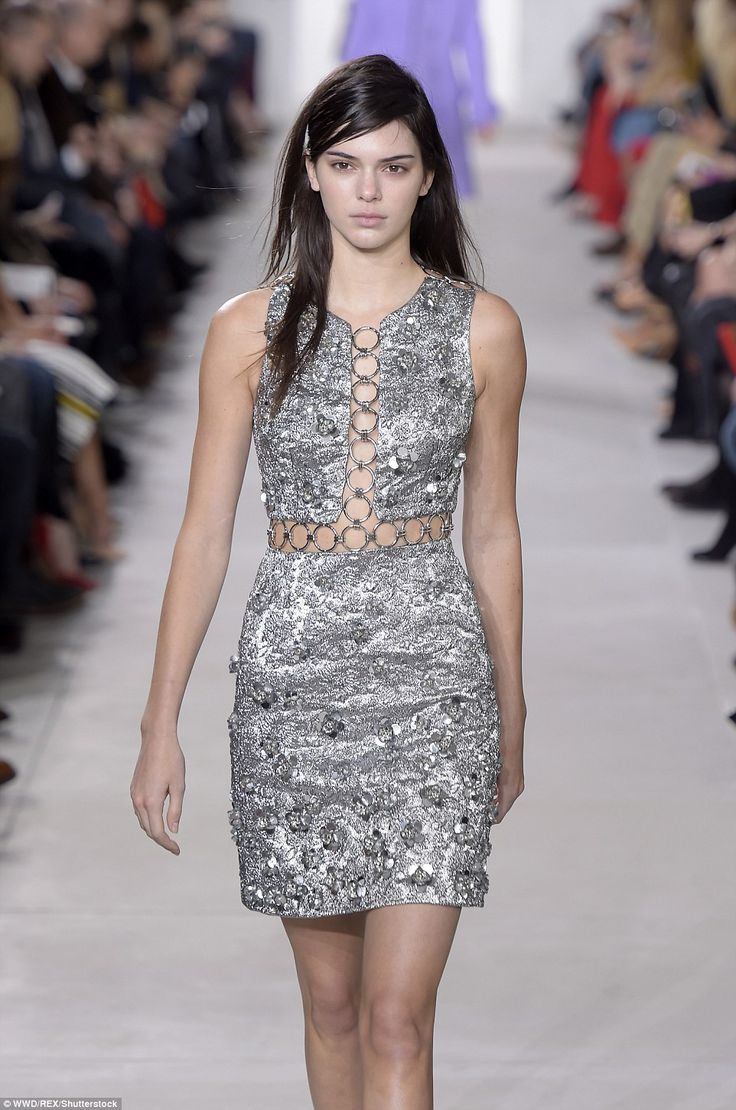 Hot metal:The budding model kept her face expressionless as she wore a silver mini-dress with a cutaway design showcasing her creamy skin tone