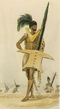 V-shaped breastplate and unusually shaped shield of the Southern Sotho, and ostrich feather in the headdress