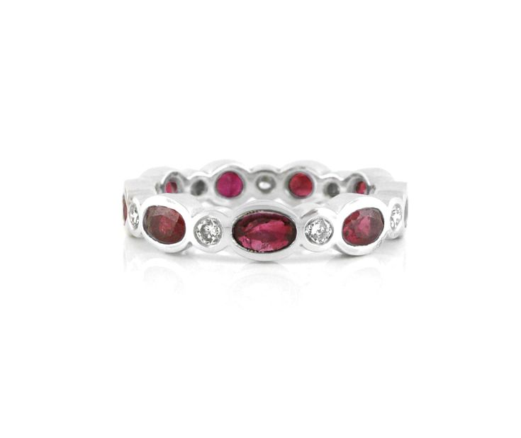 An 18ct White Gold, Diamond and Rubies Eternity Ring