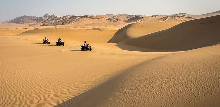 Serra Camp, Kunene, Namibia | Wilderness Safaris Cafema traverse the desert dunes on eco-sensitive quad bikes