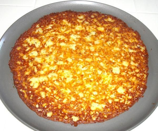 this is the crust recipe for the Atkins Induction-Friendly Low Carb Pizza     Heat oven to 450 degrees  In a bowl thoroughly combine  3 eggs  3 cups shredded mozzarella cheese  1 tsp garlic powder  1 tsp basil  press evenly into Pam sprayed pizza pan or cookie sheet  (this makes one 16 inch pizza crust)  Bake at 450 degrees until golden brown (about 10 to 15 minutes)