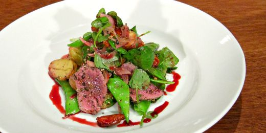 Warm venison and potato salad with a plum dressing