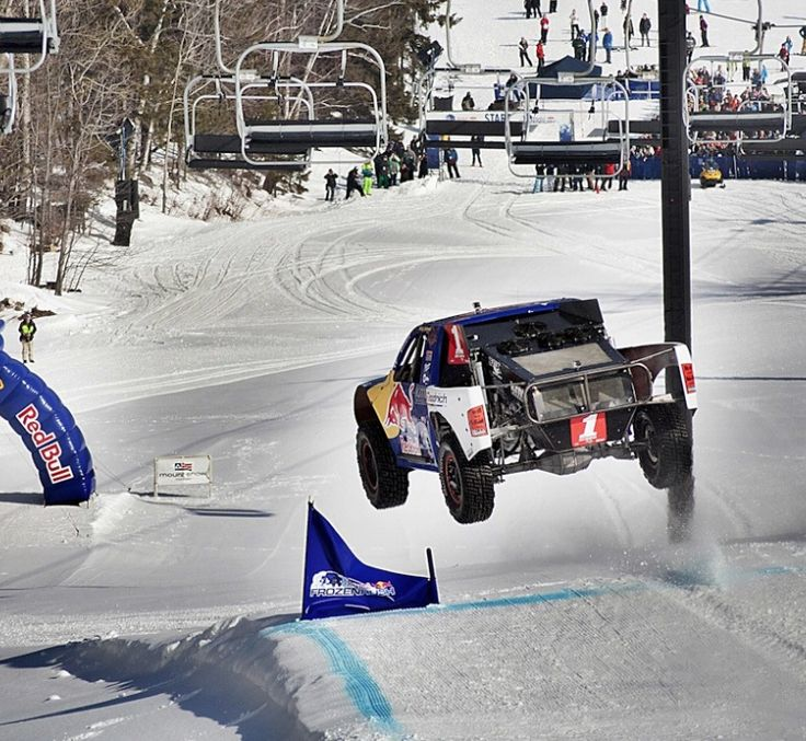 Red Bull Frozen Rush. It's wintersports, redefined! Click on the truck to see 900-hp trucks race head-to-head on the mountain slopes!