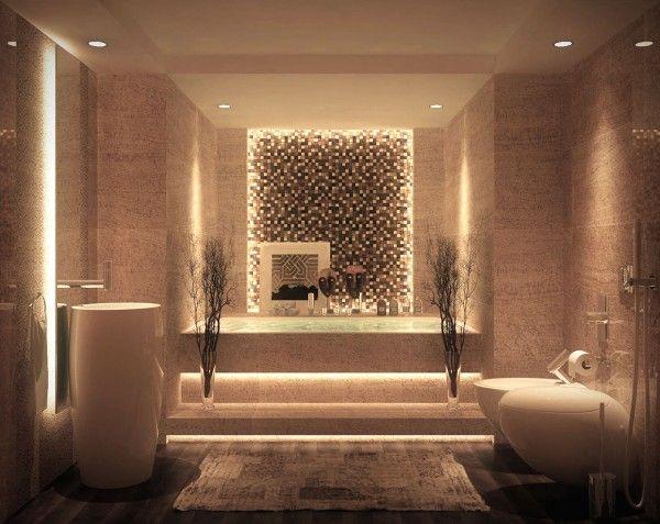 Una pared de acento azulejos moderno junto con una plataforma importante para almacenar varias burbujas, jabones y perfumes hacen de esta bañera de otra opción indulgente.