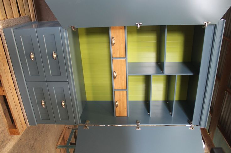 Pantry cabinet in Dove Blue with Leaf-green backing and bamboo drawers
