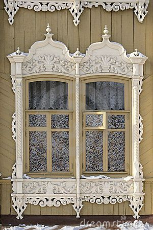 Old Russian windows in Tomsk by Alexey Kustov, via Dreamstime