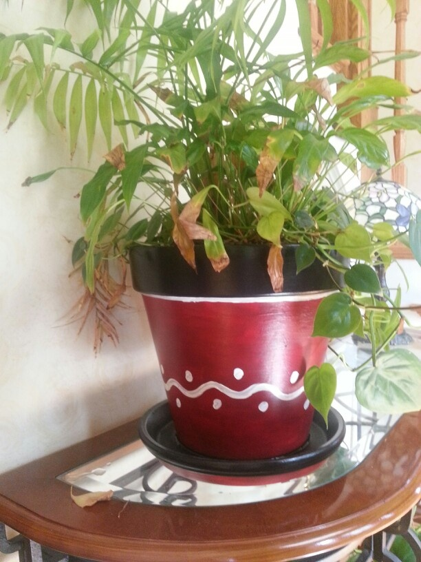 Red/black painted terra cotta pot