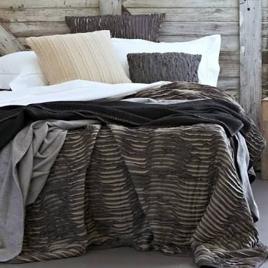 Layered bedding creates a warm and cozy sleeping environment. Be sure to add textures such as knits and soft fabrics. Photo credit- jasminehall.com.au