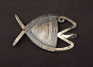 """Calder: Fish brooch, c. 1940  Silver and steel wire  3 3/8"""" x 5 3/8""""  Calder Foundation, New York"""