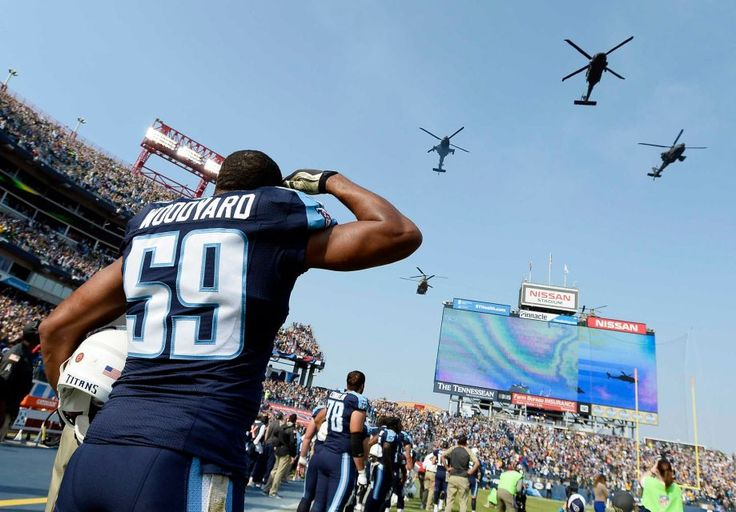 Packers vs. Titans:  47-25, Titans  -  November 13, 2016  -      Tennessee Titans linebacker Wesley Woodyard (59) salutes as helicopters fly over Nissan Stadium during the Salute to Service pregame activities before an NFL football game between the Tennessee Titans and the Green Bay Packers Sunday, Nov. 13, 2016, in Nashville, Tenn.