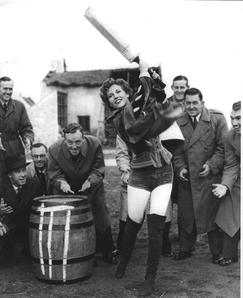 1949. Actress Rona Anderson entertains the touring New Zealanders (including Richard Hadlee's father, Walter, kneeling second left.