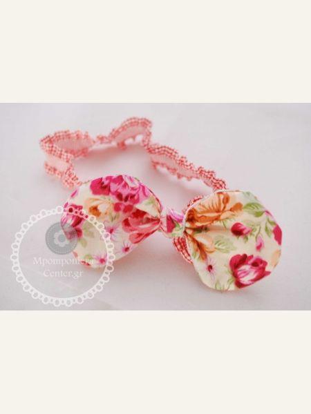 Φιογκάκι  στρογγυλεμένο φλοράλ σε φούξια-ροζ , λαστιχένια στέκα ιδανική για μωρά.