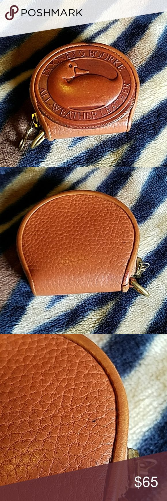 Dooney and Bourke Big Duck coin purse Dooney and Bourke Big Duck coin purse.  Tiny mark on back and small ink spot on trim near zipper.  GUC.  Tan all weather leather with British tan trim Dooney & Bourke Bags Wallets