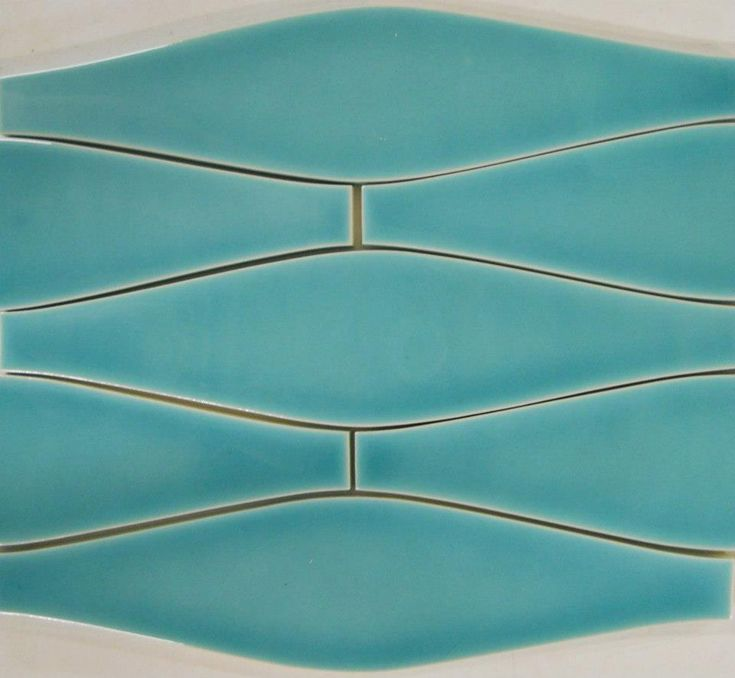 Elongated Ogee shaped tile. Love it in turquoise blue for a bathroom. Looks like water rippling.