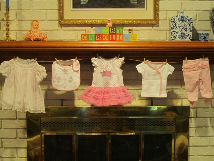 Baby shower clothesline mantle decor she 39 s crafty for Baby shower clothesline decoration