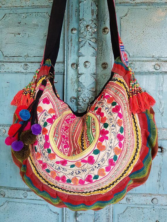 Vintage Hmong Fabric Tribal crossbody bag Hand embroidery Birds and flowers Ethnic Fahsion Measurements: 22(56.5cm.) X 16(41.5cm.) Strap drop: 20(51.5cm.) Designed from Nature, Handcrafted in Quality. Hi my Name is Nuk, Ive been designing and making bags for over a decade, and on etsy for almost the same time. I go to the tribal markets and villages to find beutiful one of a kind treasure from tribal communities and start the journey of upcycling it into a Lavish Lanna bag. I wash the…