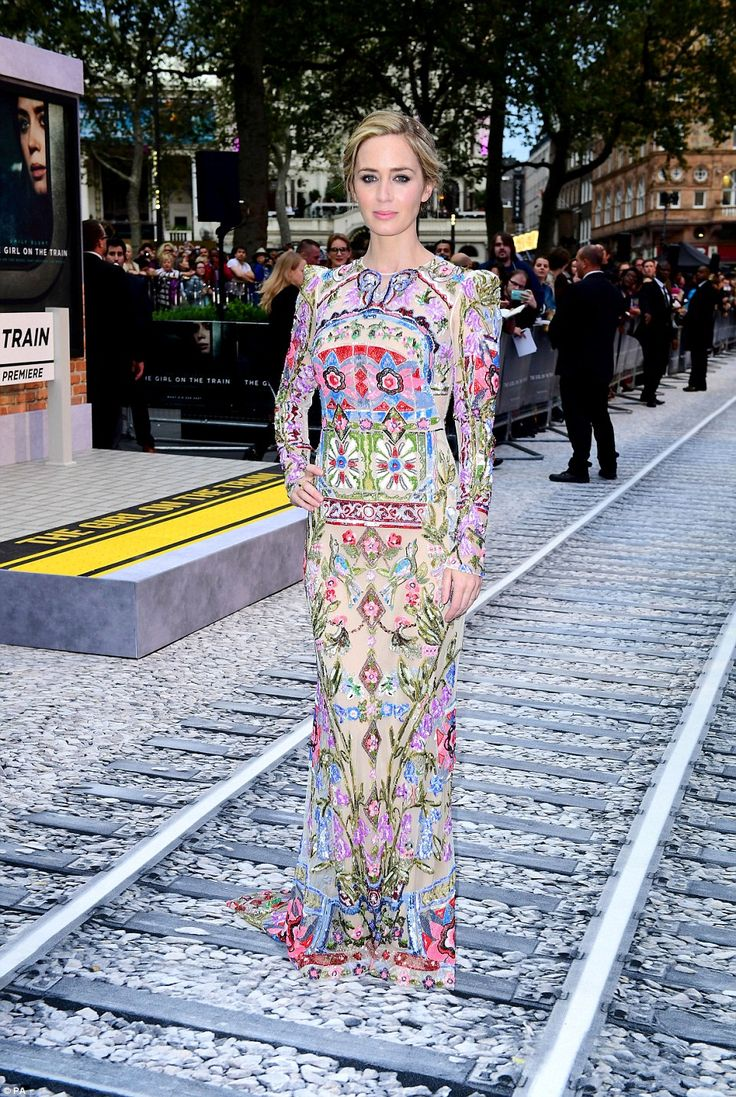A vision:The 33-year-old Devil Wears Prada star, who gave birth to her second child just three months ago, looked phenomenal in a brightly coloured floral gown which nipped in at her waist before cascading into a floor-sweeping pillar base