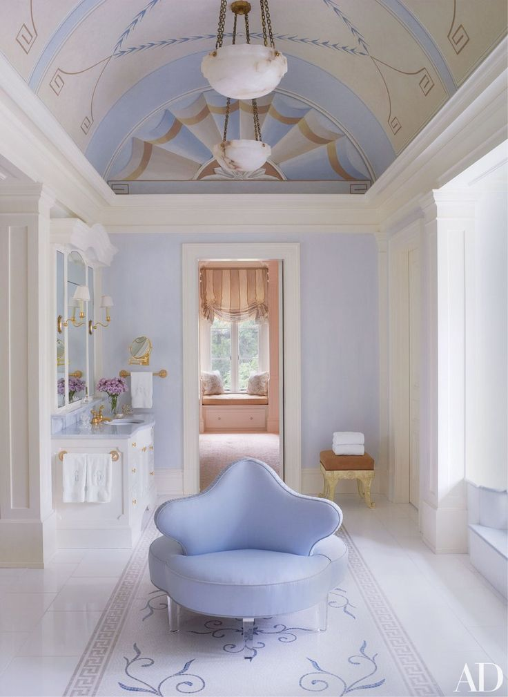 In a Virginia house decorated by Bunny Williams, the master bath's barrel ceiling was painted by Bob Christian Decorative Art, the custom-made borne by A. Schneller Sons is covered in a Summer Hill fabric, and the mosaic floor tile is by Studium.