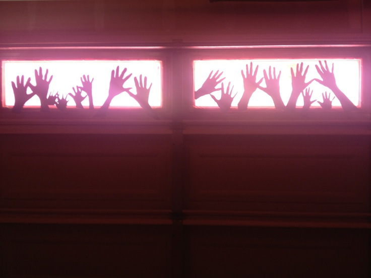 Creepy hands on the garage doors begging to get out-Halloween decor. So simple. 5$ project to do with the kids