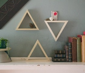 I like this...smaller unique shelves above a shelf. of 3 Triangle Shelves