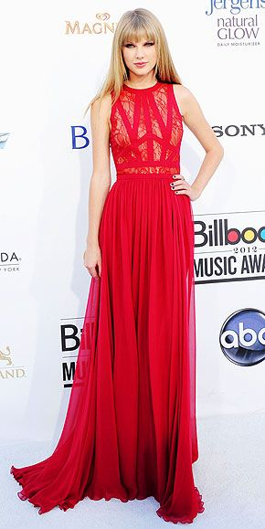 Lady in red! The usually demure country singer opts for a more grown-up look – and totally pulls it off thanks to a stunning red Elie Saab gown with sheer lace paneling, plus Neil Lane jewelry.
