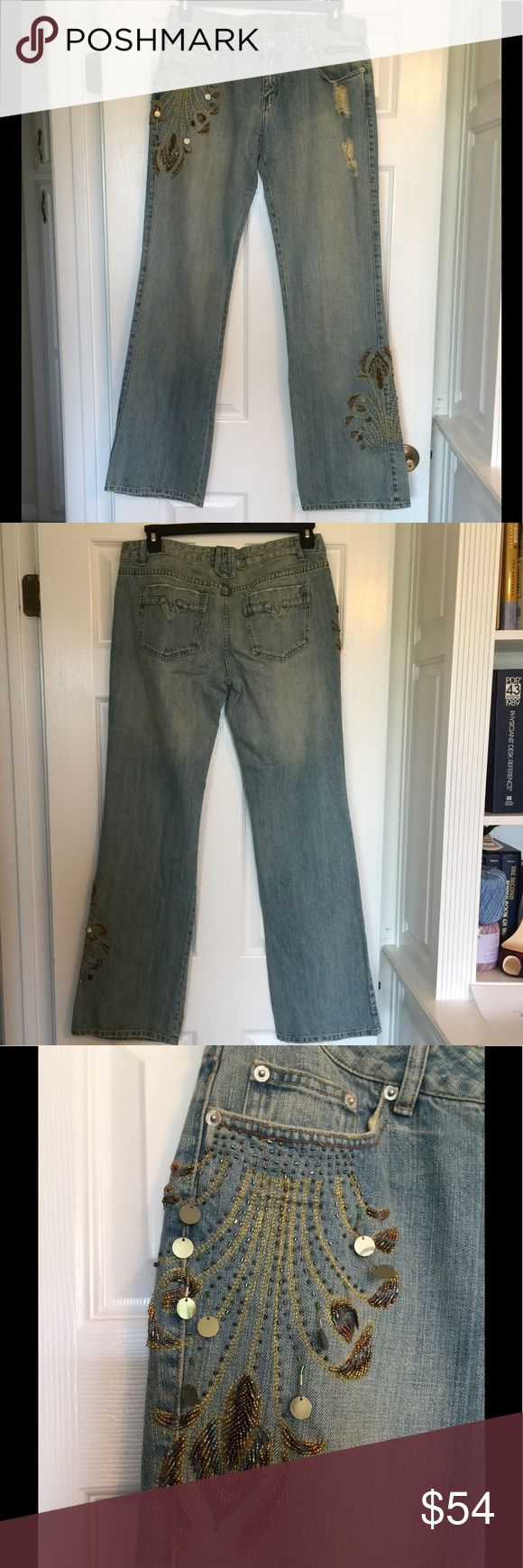 "Peppe Peluso Distressed Jeans - Size 12- NWT Peppe Peluso Distressed Jeans ~ Size 12 ~ NWT ~ Bead Detail on Right Front Hip and Left Leg Calf ~ Button / Zipper Fly ~ 4 Pockets ~ Approximate Measurements Lying Flat: Waist 17"" Inseam 33"" Peppe Peluso Jeans Flare & Wide Leg"