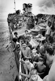 Vietnamese refugees crowd the deck of the freighter Hai Hong as the vessel rides at anchor off Port Klang, Malaysia, November 22, 1978. More than 2500 refugees have spent a month aboard the ship as the Mayasian government negotiates their fate with third world countries. The Malaysians contended that the Vietnamese were migrants, not true refugees. (Canadian Press)