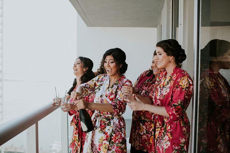 Luxe Romantic Glamour on the Miami Waterfront | Miami | WEDDING VENUE + CATERING The Rusty Pelican | PHOTOGRAPHERS Cheryl & Jay Wedding Photographers | DJ LR Entertainment | CAKES & DESSERTS Edda's Cake Designs | CINEMATOGRAPHERS Wedding Cinema | FLORIST Ala's Flowers | HAIR & MAKEUP Just Naivi | PLANNERS & DESIGNERS Soco Alicea | matching robes