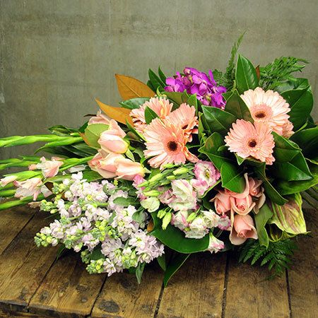 """Buy """"Fresh Pink Sheaf"""" for $185.95. A Fresh Funeral Sheaf Of Flowers Featuring A Mixed Array Of Blooms Including Pastel Pink Gerbera Daisies, Frilly Stock, Gorgeous Roses And Lisianthus, Gladioli, And Vibrant Orchids. Clustered Amongst Lush Green Ferns And Foliage, This Flat-backed Sheaf Of Flowers Can Be Ordered For Sydney Funerals Via Our Online Florist Shop Or By Calling The Team. *please Note: This Funeral Flower Design Is Exclusive To Sydney Delivery Only. For Funeral Flowers Delivered…"""