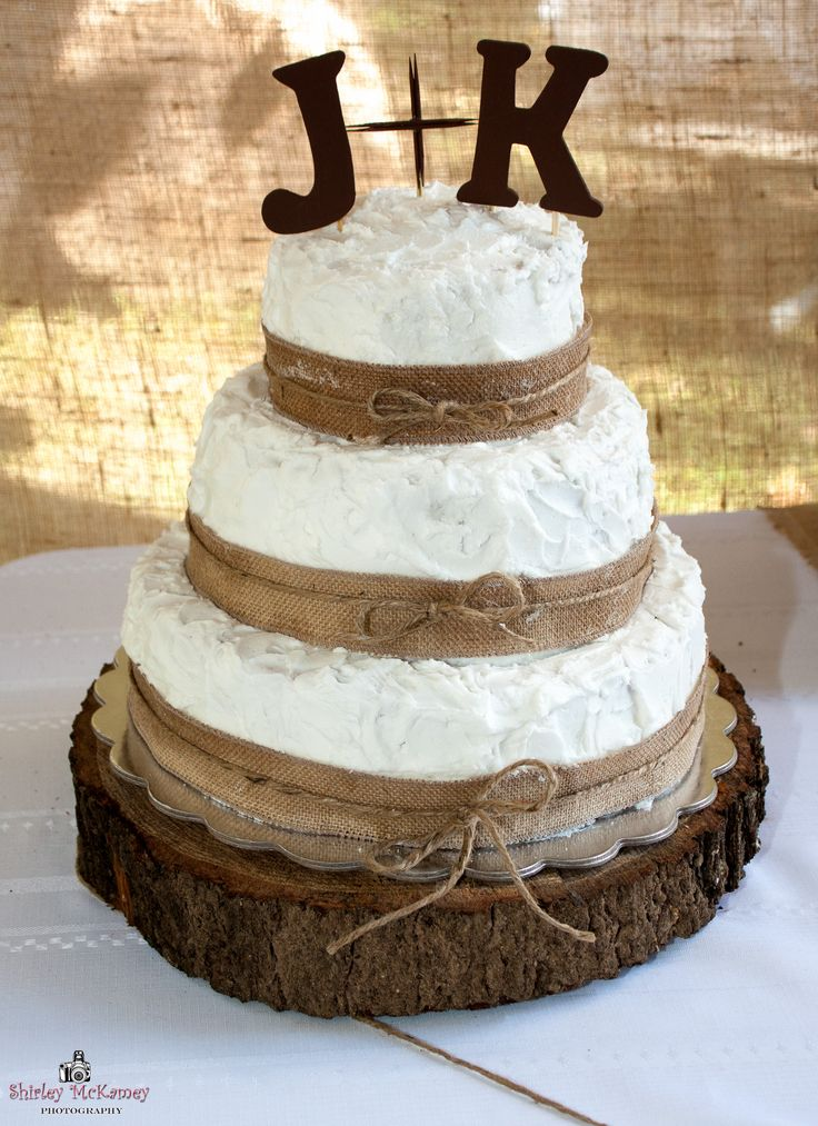 3 tier wedding cake decorated with burlap ribbon twine with wooden letters as topper cake. Black Bedroom Furniture Sets. Home Design Ideas