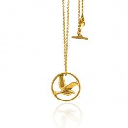 Bird in Circle - Danish Design. The 22-karat gold plated sterling silver version of Pernille Vinderskov's Bird in Circle pendant necklace is fit for a queen. The simplicity in design and shining material give it an elegant and timeless look. The way Vinderskov has carved bird in flight but trapped in the circle plays with the theme of wildness and captivity. This beautiful and thought-provoking necklace is the perfect accessory for any occasion. http://www.nuuru.com/en/bird-in-circle-fg.html