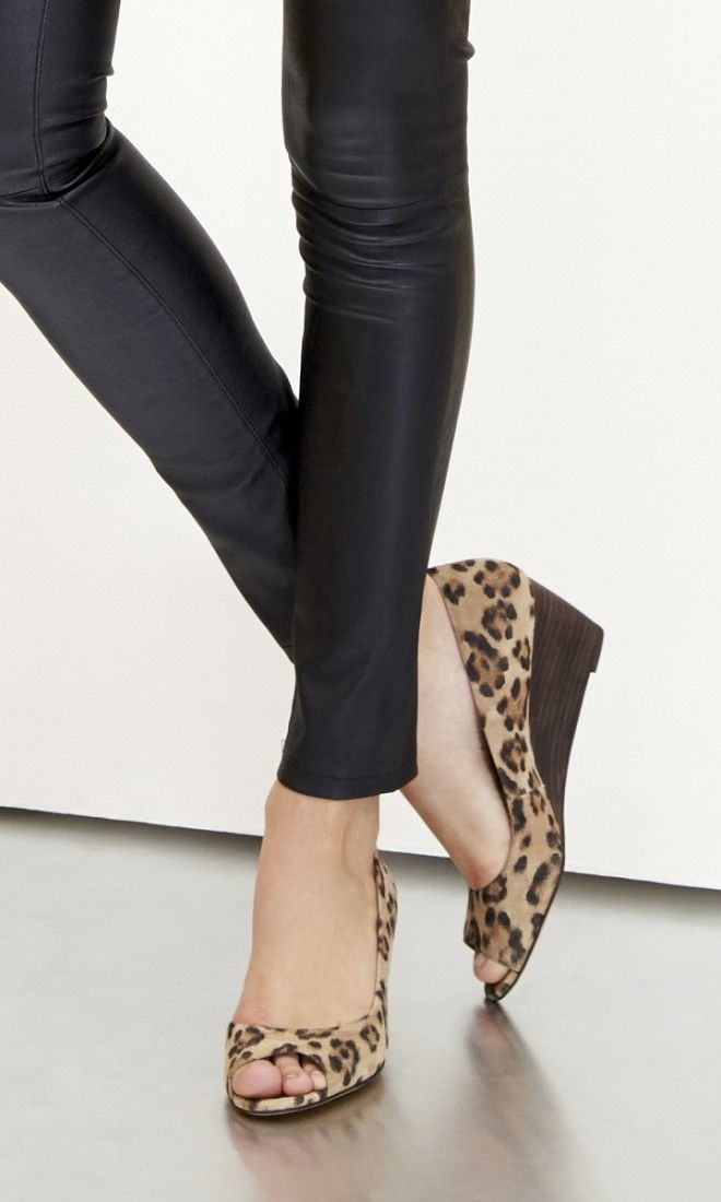 Mini wedge with a peep toe and stacked heel. Ideal for the workweek.