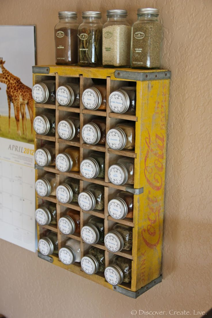 Coca-Cola crate to store spices - would be even better with blackboard painted lids on the jars to note spice names in chalk!