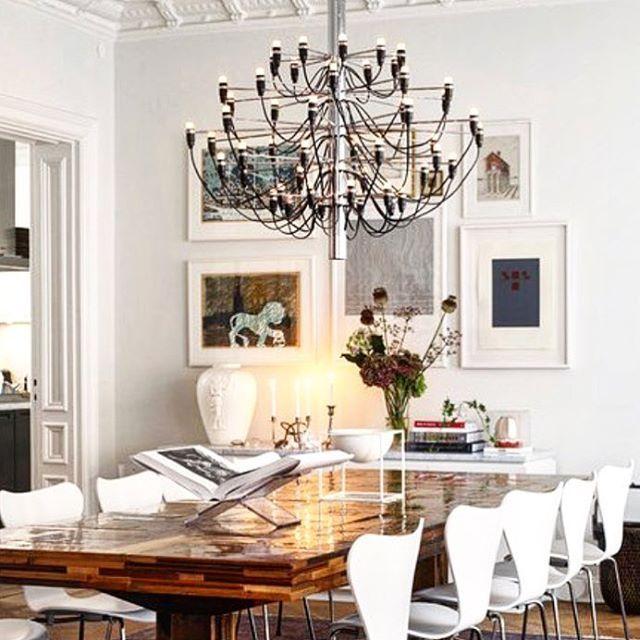 Gorgeous dining room. #flos #chandelier #diningroom
