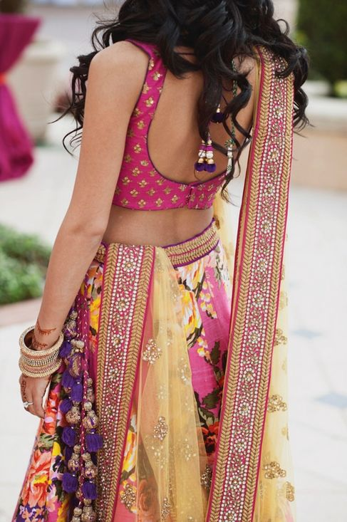 Love the floral pattern and fresh spring colors! | Bright Indian Outfits for the Wedding season on www.faaya.in
