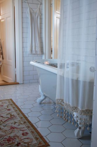 beautiful tiles on this bathroom floor and I Loveee the bear claw tub. * i have always wanted one.