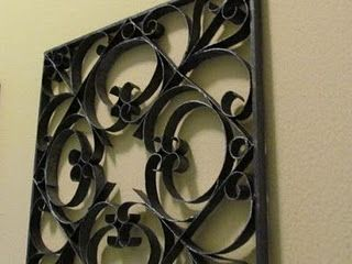 Making these and hanging on an opposing wall could help tie in the wrought iron mirror and table.