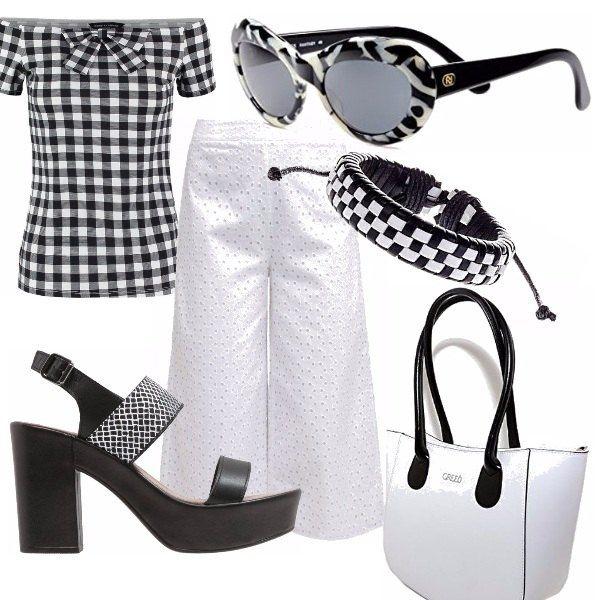 Bianco nero sono due colori senza tempo. Outfit pratico ed essenziale dal tocco ricercato. Pantaloni bianchi 7/8 in pizzo sangallo, abbinati ad una camicetta bianca e nera a quadri che lascia scoperte le spalle. Sandali alti con zeppa, occhiali bianchi e neri dal sapore retrò, borsa bianca con manici neri. Bracciale bianco e nero.
