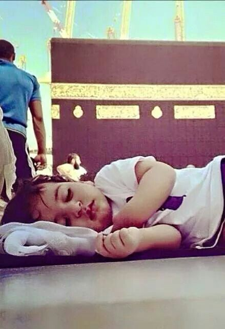 Sweet little boy taking a nap near kabe